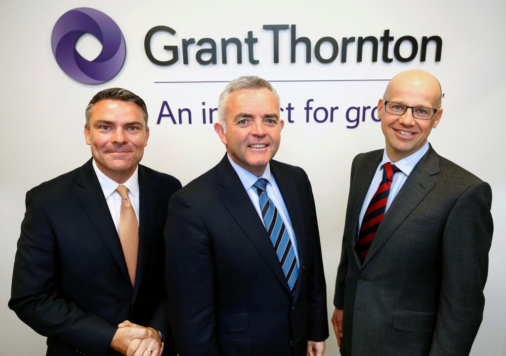 Pictured with Minister Jonathan Bell at the company offices are Mark Cardiff, Head of Audit, Grant Thornton UK LLP and Richard Gillan, Partner in Charge, Grant Thornton NI LLP.Photographer William Cherry / Press Eye.