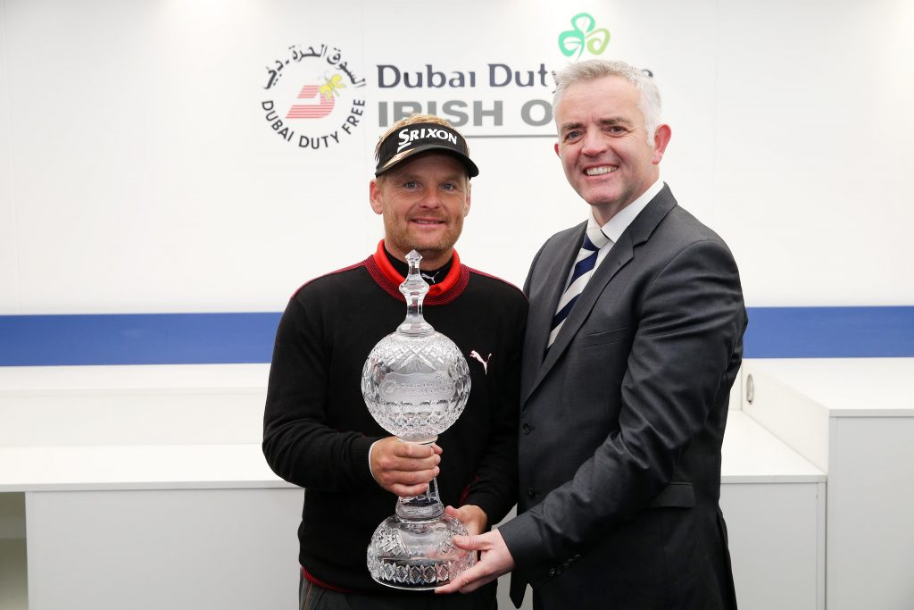 S¿ren Kjeldsen, winner of the Dubai Duty Free Irish Open hosted by the Rory Foundation is presented with the trophy by Enterprise, Trade and Investment  Minister Jonathan Bell. Picture by Kelvin Boyes / Press Eye.