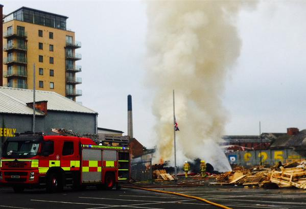 The scene this morning as a bonfire in Sandy Row is set alight
