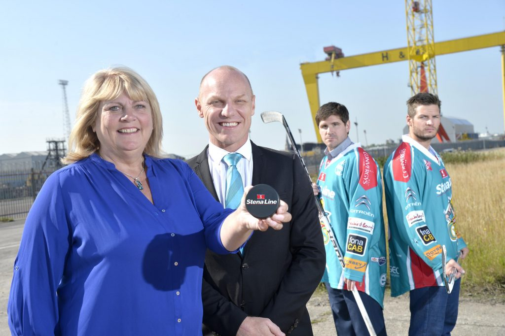 Diane Poole, Head of PR and Communications at Stena Line and Steve Thornton, Head of Hockey Operations at the Stena Line Belfast Giants celebrate with players Adam Keefe and Brandon Benedict after securing their biggest re-signing of the season as the leading ferry company announced that it will once again become the ice hockey team's title sponsor in 2015/2016, for the fifth successive year.