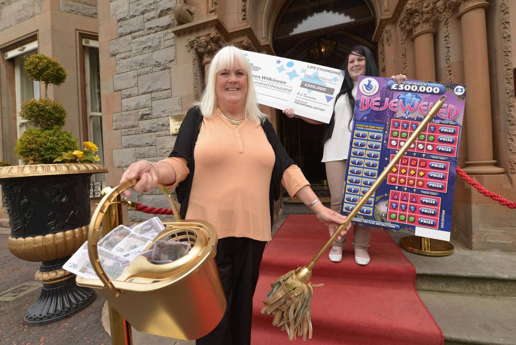 CLEANING UP:  (l-r) Belfast cleaner Maureen Wilkinson (58) celebrates with her daughter Kimberley McCaughey at the five-star Culloden Hotel after scooping a massive £300,000 on a National Lottery Scratchcard.  Maureen, from the Cregagh area in the east of the city, cleaned up when she matched three figures on the National Lottery Bejeweled Scratchcard that she purchased from her local Mace store in Greenway.  The Bejeweled Scratchcard costs £3 and offers a 1 in 3.71 overall chance of winning a prize, which can range from £3 to the top prize of £300,000.  Maureen has no plans yet on how she'll spend all the money but already has her eye on a new three-piece suite for her home and, although she doesn't drive, a new car for the family.