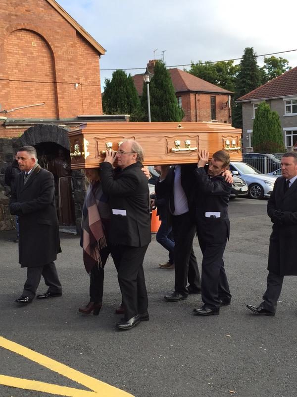 The remains of Seamus Wright carried into St Agnes Church for Requiem Mass today