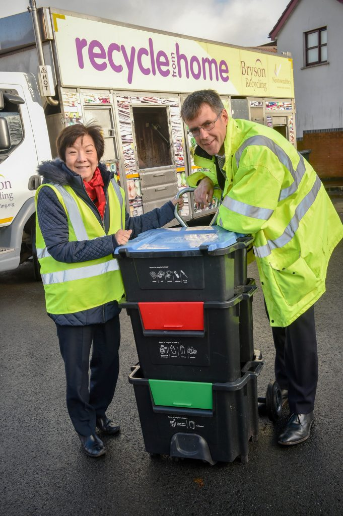 South Belfast MLA Anna Lo and Chair of the Environment Committee meets with Bryson Recycling Director Eric Randall to try out the innovative 'Wheelie Box', which could save local councils an estimated £4m each year.