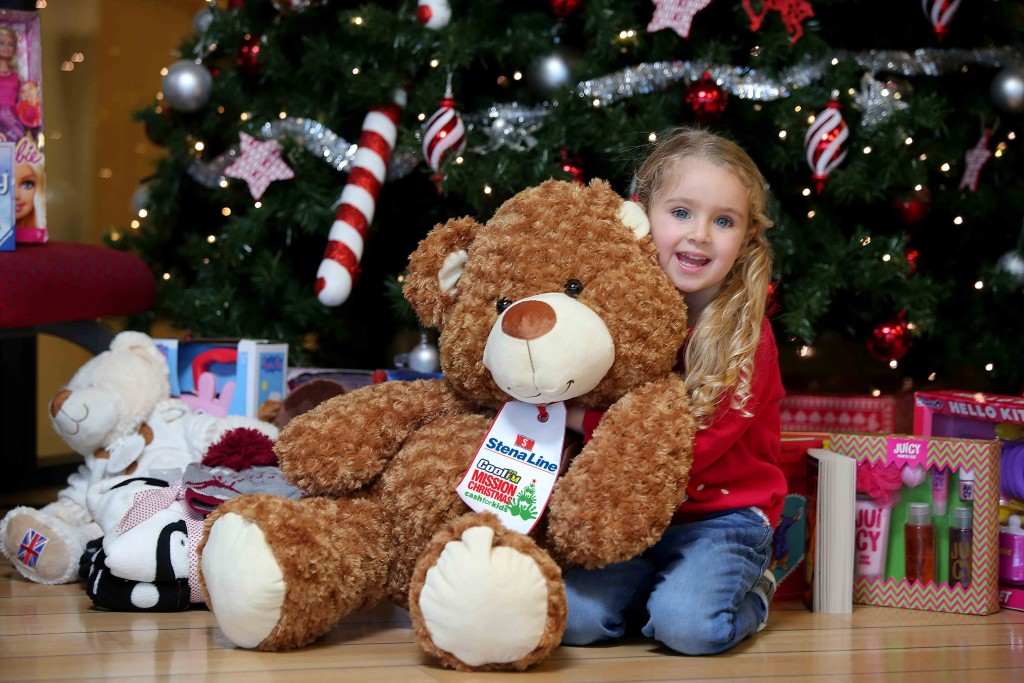 Little Cerys O'Neill (4), gets ready to donate a toy to the Cash for Kids festive 'Mission Christmas' toy campaign at the Stena Line Victoria Terminal 4 drop off point in Belfast.