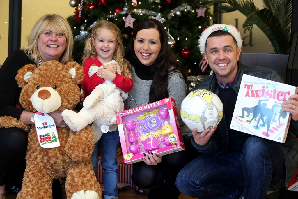 Little Cerys O'Neill (4), joins Diane Poole of Stena Line and Rebecca McKinney and Pete Snodden from Cool FM as they get ready to donate a toy to the Cash for Kids festive 'Mission Christmas' toy campaign at the Stena Line Victoria Terminal 4 drop off point in Belfast.