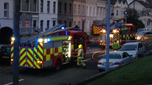 The scene in the early hours of Saturday morning when the fire engine crashed into cars and a house on Larne's Glenarm Road