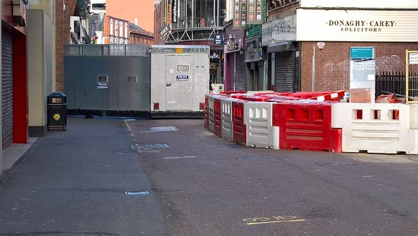 A security barrier erected in Belfast city centre this morning ahead of republican and loyalist parades