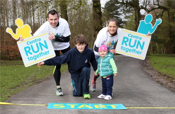 KEEP IT IN THE FAMILY: World Masters 800m champion Kelly Neely, from Lisburn, gets a little help from husband Ian, 18 month daughter Sarah and 13 year old Oliver Gilmore from Saintfield to launch a new series of fun runs across Northern Ireland. Centra Run Together is a set of four 5k races taking place across Belfast, Mid Ulster and Derry. Photographer Darren Kidd / Press Eye