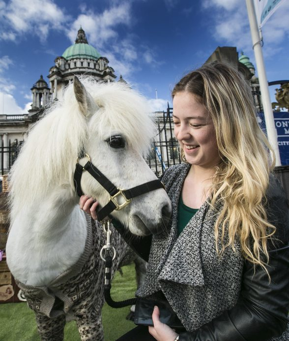 Ponies in PJs 'Mane' Attraction at Belfast City Hall: Hamish the Shetland pony was the 'mane' attraction cheering up commuters in his PJs at Belfast's City Hall this morning to shake off any Monday morning blues as VisitScotland research revealed that three quarters of Northern Irish workers are impacted by 'Sunday Night Fear' and lack of weekend adventures. Commuter Sarah Adams from Lisburn, is pictured horsing around on her way to work with the miniature star. Picture by Brian Morrison