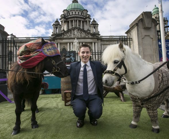 'Neigh' Worries as Commuters Cheered Up by Scottish Ponies: L'Derry man Kevin Bradley checks out the 'mane' attraction at Belfast City Hall as Shetland ponies in pyjamas brought cheer to the dreaded Monday commute. Research from VisitScotland revealed three quarters of Northern Ireland Irish workers are impacted by 'Sunday Night Fear,' with the organisation calling for more weekend adventures. Picture by Brian Morrison