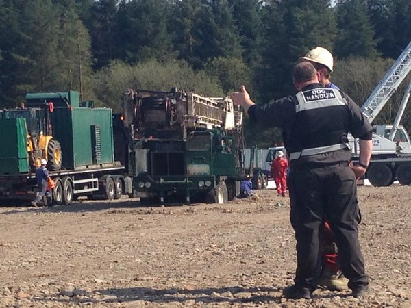 WHACK WHACK OOP...Huge oil rig brought into drill at Woodburn Forest sinks into the soft ground beneath