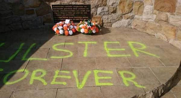 Graffiti daubed on republican memorial stone at Milltown Cemetery in west Belfast