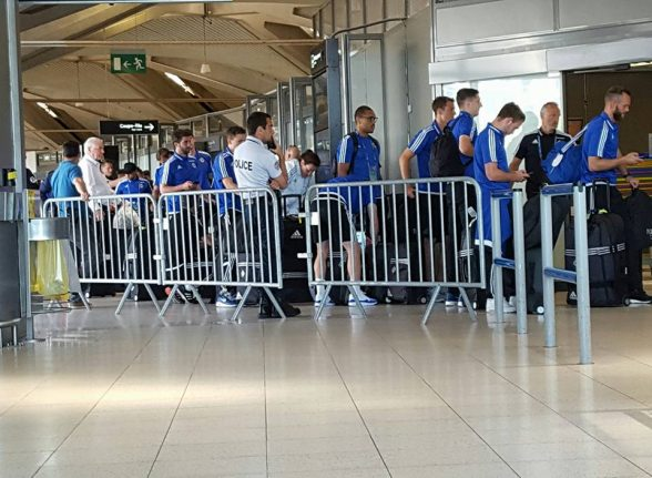 The Northern Ireland team checking into Paris airport ahead of their flight home to Belfast and a heroes welcome at the Fanzzone