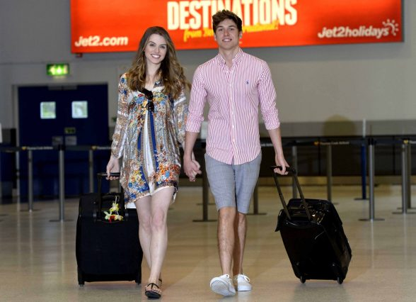 WINTER WARMERS… Lucy Evangelista and James McDowell get ready to swap their winter woollies for their shorts and t-shirts after Jet.com and Jet2holidays announced their biggest ever winter programme from Belfast International Airport.