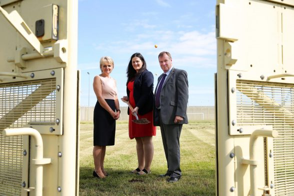 Justice Minister Claire Sugden cuts the first sod in preparation for the construction of a new cell block at Maghaberry Prison. She is pictured with Sue McAllister, Northern Ireland Prison Service Director General and Stephen Davis, Governor of Maghaberry. Picture by Kelvin Boyes / Press Eye.
