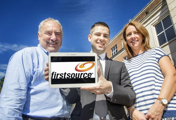 Tim Moruzzi, Ulster University Business School and Programme Director with Firstsource Belfast Employee John McClenaghan, pictured with Fiona Murray, Human Resources , is one of 280 employees worldwide studying for his Contact Centre Management Degree with the company.