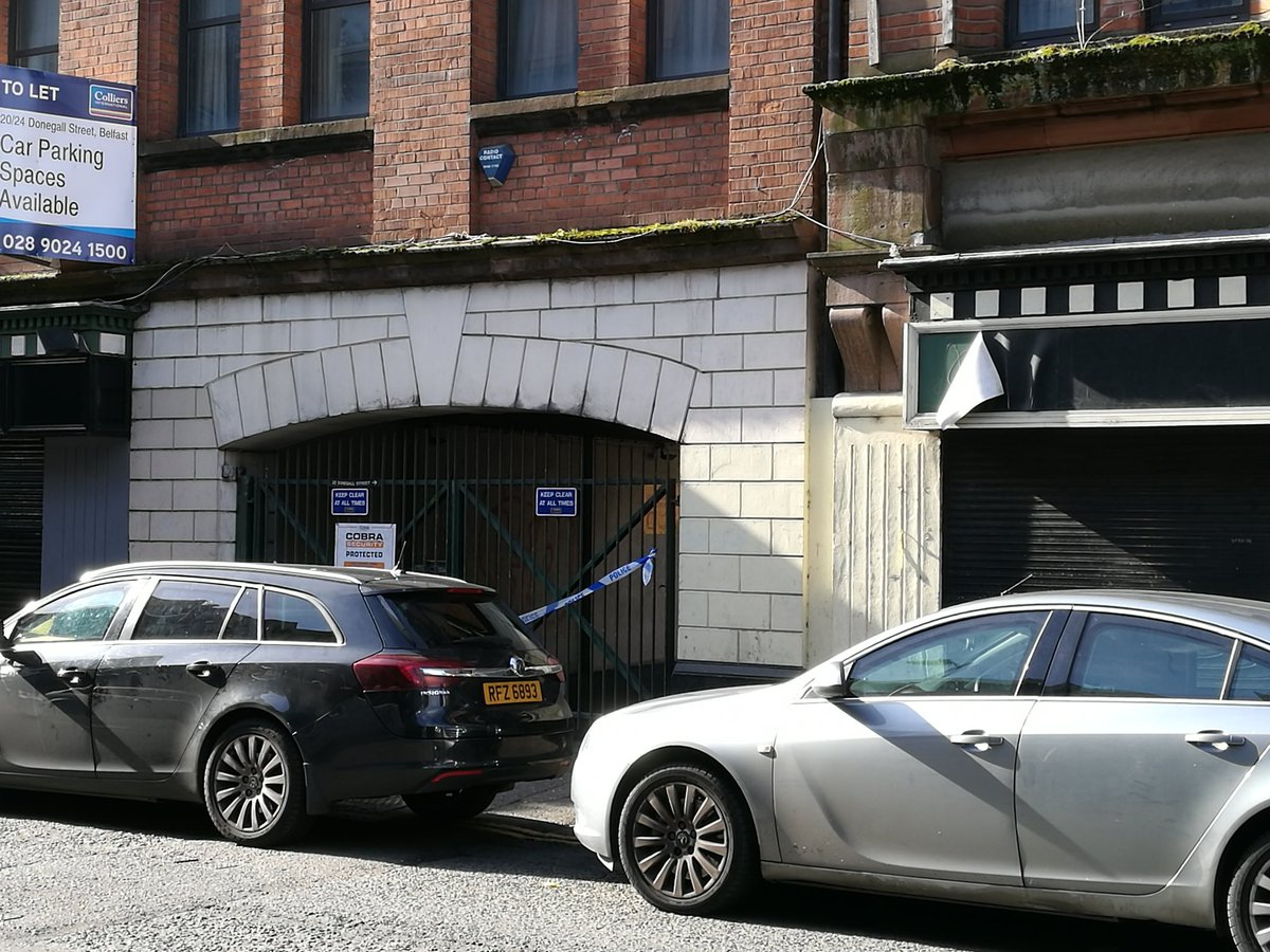 Police at the scene where a man's body was found in lower Donegall Street last night