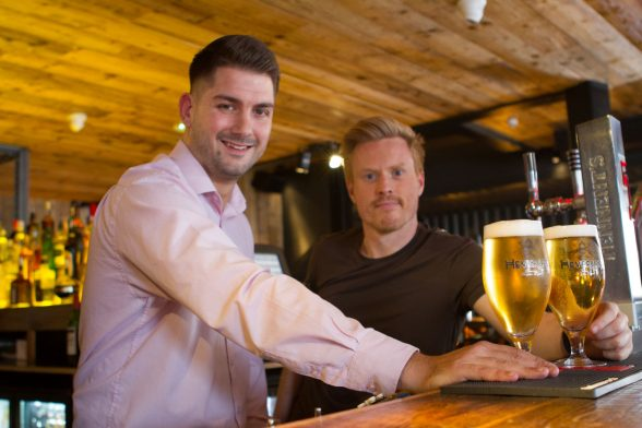 Manager of Cuckoo James O'Donnell joins Beannchor Group's Conall Wosley to celebrate the launch of the newly renovated Lisburn Road bar which has reopened its doors to the public following a £450,000 refurbishment.