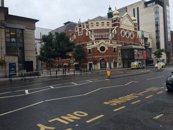 The scene in Great Victoria Street where area is cordoned by police at Grand Opera House