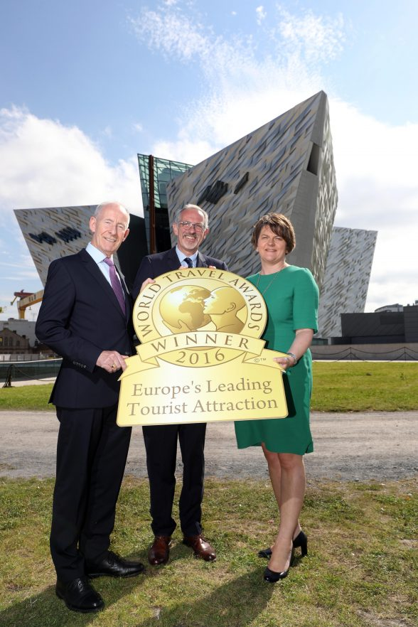 First Minister Arlene Foster joins celebrations with Titanic Belfast's Vice-Chairman Conal Harvey (left) and Chief Executive Tim Husbands MBE (centre), as it is named as Europe's Leading Visitor Attraction at the prestigious World Travel Awards held in Sardinia, Italy, last month beating off stiff competition from The Eiffel Tower, France and The Roman Colosseum, Italy.