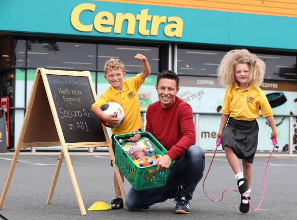 LOCAL personality, Stephen Clements of Q Radio's breakfast show, has been announced as Action Cancer's Health Action programme Ambassador. Pictured with Stephen are KingÕs Park Primary School, Newtownabbey, pupils Ross (7) and Heidi (6) Campbell. Picture by William Cherry / Press Eye