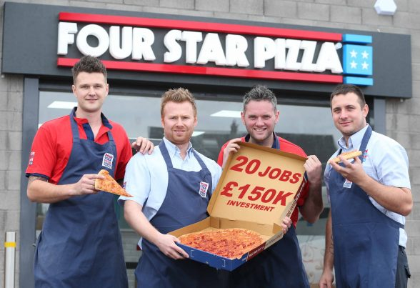 Darren Colgan (second left), owner of the new Bangor Four Star Pizza store, is joined by some of his team to celebrate the opening of the store which also has a sit-in area. The store officially opened its doors at Unit 3, 81 Gransha Road (BP station complex), on October 11, as part of a £150,000 investment which will create 20 jobs in the area. Darren now owns three stores – Armagh, Newry and Bangor - and over the past 12 years, he and his team have delivered no fewer than 374,000 fresh pizzas, used 32 tonnes of flour, 16 tonnes of cheese and 5 tonnes of pepperoni. Get in touch with Four Star Pizza Bangor by calling 028 9185 9777, visit their website, www.fourstarpizza.co.uk, download the Four Star Pizza app or visit their Facebook page, www.facebook.com/Four-Star-Pizza-Bangor-1251888334821181, or alternatively, visit the store on Gransha Road, Bangor.