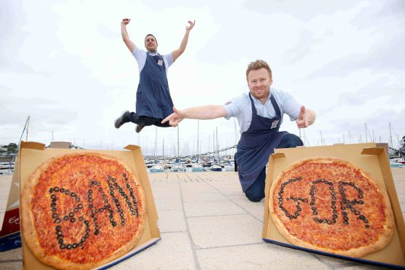 Darren Colgan (front), owner of the newly opened Bangor Four Star Pizza store, was at Bangor Marina with team member, Bela Deak Vesci, to celebrate the opening of his store which also has a sit-in area.