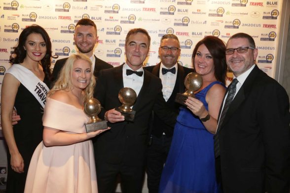 FLYING HIGH: Package holiday specialist scores hat-trick at the 25th annual Blue Insurance Northern Ireland Travel and Tourism Awards. Pictured (l-r) Nikki Porter, Simon Marshall, James Nesbitt, Craig Davidson, Helen Parry and Alan Cross.