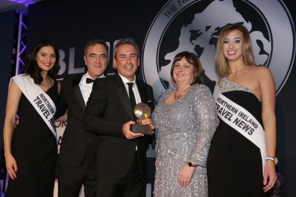 Paul Grant, Route Manager Irish Sea North for Stena Line (centre), collected the award on the night, and is pictured here with (L-R): Zara Shaw, Awards presenter James Nesbitt, Julie Hastings of category sponsor Hastings Hotels, and Sara Moore.