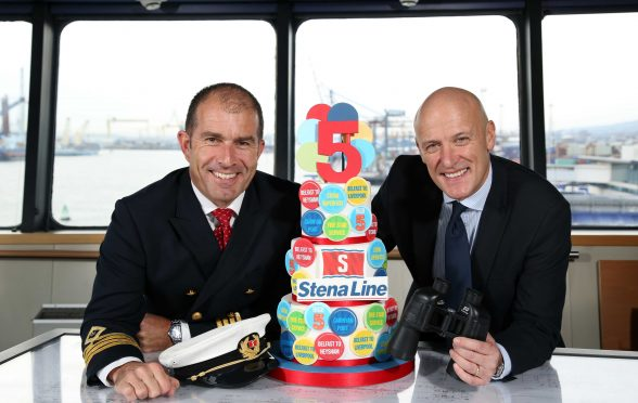 HIGH FIVE...Stena Line's Cpt Alistair McCarlie and Onboard Sales and Service Manager Stephen Bryden celebrate five years of Stena Line's Belfast – Cairnryan ferry service. Since the opening