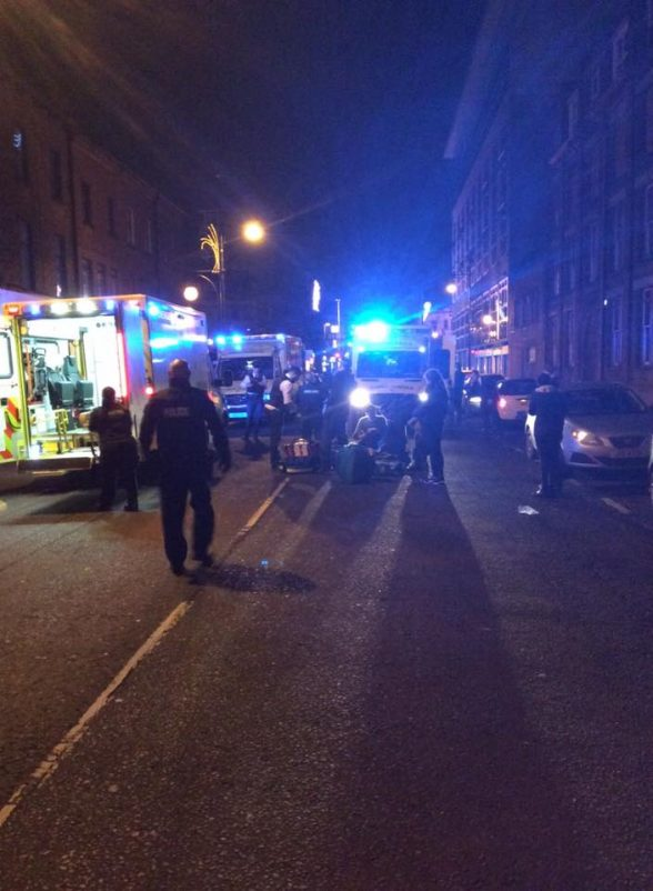Police teams and paramedics dealing with three collapsed males in Belfast city centre